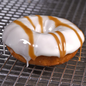 Banana covering with a glaze drizzle topped with powdered sugar