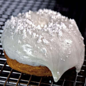 Lemon covering with a glaze drizzle topped with powdered sugar