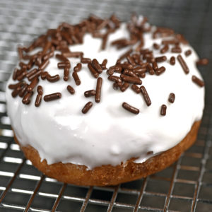 Vanilla covering topped with chocolate sprinkles
